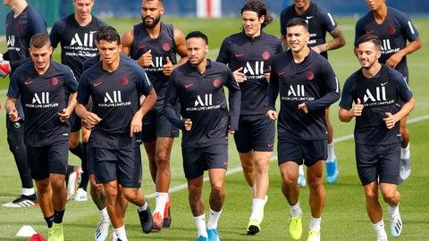 <p>               PSG's Neymar, third left, runs with teammates during a training session at Camp des Loges in Saint Germain en Laye, outside Paris, France, Saturday, Aug. 10, 2019. (AP Photo/Francois Mori)             </p>