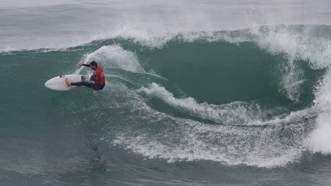 <p>               Argentina's Santiago Muniz competes in the men's open surfing repechage round 2 during the Pan American Games on Punta Rocas beach in Lima Peru, Wednesday, July 31, 2019. (AP Photo/Silvia Izquierdo)             </p>