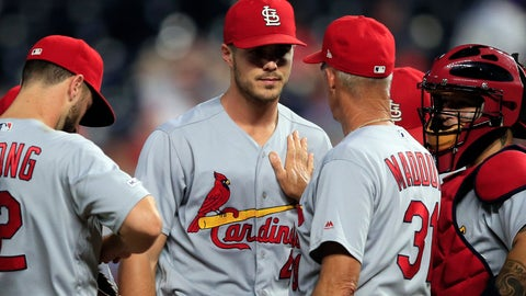 <p>               St. Louis Cardinals starting pitcher Dakota Hudson, facing camera, has a talk with pitching coach Mike Maddux (31) during the sixth inning of the team's baseball game against the Kansas City Royals at Kauffman Stadium in Kansas City, Mo., Wednesday, Aug. 14, 2019. (AP Photo/Orlin Wagner)             </p>