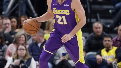 <p>               FILE - In this March 19, 2018, file photo, Los Angeles Lakers' Travis Wear plays during the first half of an NBA basketball game against the Indiana Pacers, in Indianapolis. Wear is one of the G League players who helped USA Basketball qualify for the World Cup, and now he and a few others are being brought back to the team for the final week of training camp against NBA players who will actually play in the tournament in China later this month. (AP Photo/Darron Cummings, File)             </p>