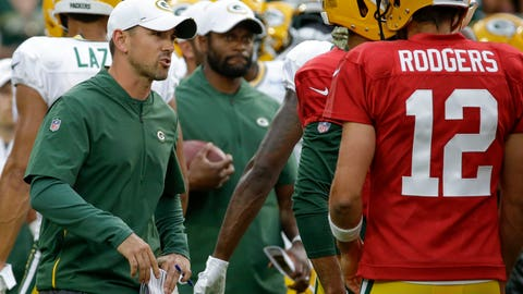 <p>               Green Bay Packers coach Matt LaFleur, left, talks with quarterback Aaron Rodgers during the NFL football team's Family Night practice Friday Aug 2, 2019, in Green Bay, Wis. (AP Photo/Mike Roemer)             </p>