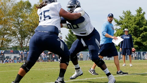 <p>               FILE - In this July 30, 2018, file photo, Tennessee Titans offensive guards Xavier Su'a-Filo (76) and Kevin Pamphile (66) run a drill during NFL football training camp in Nashville, Tenn. Pamphile says this is the first training camp he's seen coaches switching up along the offensive line, and the Tennessee Titans are letting the competition continue into the third week of the preseason. (AP Photo/Mark Humphrey, File)             </p>