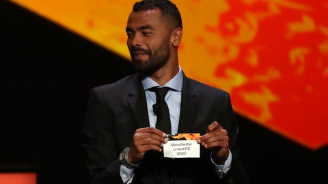 <p>               Former Chelsea defender Ashley Cole shows the name of Manchester United during the UEFA Europa League group stage draw at the Grimaldi Forum, in Monaco, Friday, Aug. 30, 2019. (AP Photo/Daniel Cole)             </p>