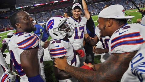 """<p>               Buffalo Bills' Christian Wade (45), center, celebrates his touchdown with teammates during the second half of an NFL preseason football game against the Indianapolis Colts, Thursday, Aug. 8, 2019, in Orchard Park, N.Y.  Wade gave up a promising career representing England in rugby to give American football a try. On his first play from scrimmage in a competitive setting, the 28-year-old from Slough _ best known for home of the BBC's version of """"The Office"""" sitcom _ scored a touchdown on a 65-yard run to help the Buffalo Bills secure a 24-16 preseason-opening win over Indianapolis. (AP Photo/Adrian Kraus)             </p>"""