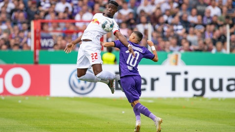 <p>               Leipzig's Nordi Mukiele, left, challenges for the ball with Osnabrueck's Anas Quahim, right, during the German soccer cup, DFB Pokal, first Round match between VfL Osnabrueck - RB Leipzig in Osnabrueck, Sunday, Aug. 11, 2019. (Guido Kirchner/dpa via AP)             </p>