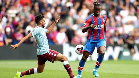 <p>               Crystal Palace's Wilfried Zaha in action during their English Premier League soccer match against Aston Villa at Selhurst Park, London, Saturday, Aug. 31, 2019. (Bradley Collyer/PA via AP)             </p>