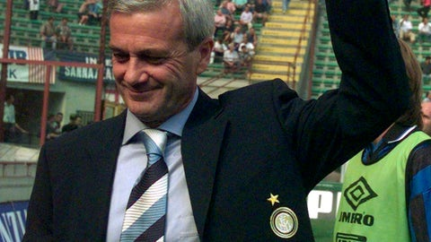 """<p>               FILE - In this file  photo taken on Aug. 31, 1997, Gigi Simoni, then coach of Inter of Milan, salutes Inter fans prior to a match at Milan's San Siro stadium. The wife of Luigi """"Gigi"""" Simoni says the former Inter Milan coach remains in critical condition after suffering a stroke in June (AP Photo/Luca Bruno)             </p>"""