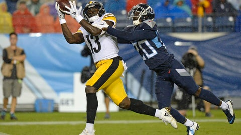 <p>               Pittsburgh Steelers wide receiver James Washington (13) catches a 41-yard touchdown as he is defended by Tennessee Titans defensive back Kenneth Durden (20) in the first half of a preseason NFL football game Sunday, Aug. 25, 2019, in Nashville, Tenn. (AP Photo/Mark Zaleski)             </p>