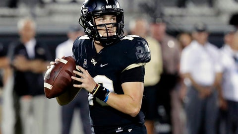 <p>               FILE - In this Sept. 21, 2018, file photo, Central Florida quarterback McKenzie Milton looks for a receiver during the first half of an NCAA college football game against Florida Atlantic in Orlando, Fla. Part of the sales pitch that lured Milton from his home state of Hawaii to UCF was a pledge by then-Knights coach Scott Frost to help put the quarterback on a path to a post-playing career in coaching. (AP Photo/John Raoux, File)             </p>