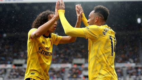 <p>               Arsenal's Pierre-Emerick Aubameyang, right, celebrates scoring his side's first goal of the game with team mate Matteo Guendouzi,  during the English Premier League soccer match between Newcastle United and Arsenal, at St James' Park, in Newcastle, England, Sunday, Aug. 11, 2019. (Owen Humphreys/PA via AP)             </p>