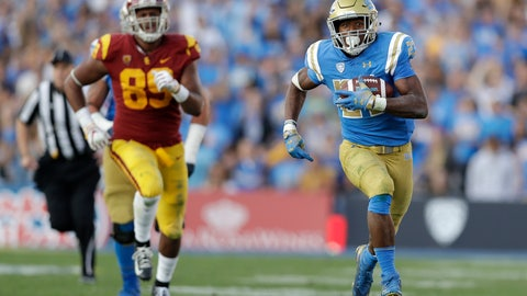 <p>               FILE - In this Nov. 17, 2018, file photo, UCLA running back Joshua Kelley, right, runs for a touchdown against Southern California during the second half of an NCAA college football game in Pasadena, Calif. The offense returns nine starters, including sophomore quarterback Dorian Thompson-Robinson and senior running back Joshua Kelley, who went for 289 yards in the victory over USC. (AP Photo/Marcio Jose Sanchez, File)             </p>