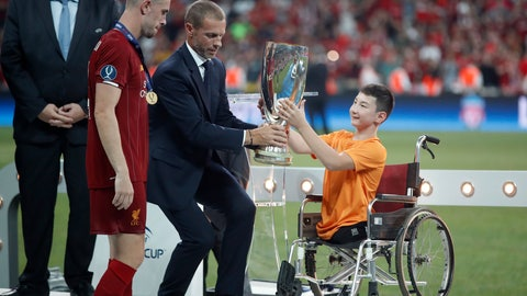 <p>               UEFA President Aleksander Ceferin and Ali Turganbekov, from Kazakhstan, right, hand the trophy to Liverpool's team captain Jordan Henderson after Liverpool won the UEFA Super Cup soccer match between Liverpool and Chelsea, in Besiktas Park, in Istanbul, Thursday, Aug. 15, 2019. Liverpool won 5-4 in a penalty shootout after the game ended tied 2-2. (AP Photo/Thanassis Stavrakis)             </p>