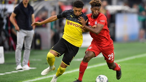 <p>               FILE - In this Saturday, Aug. 3, 2019 file photo Bayern's Kingsley Coman, right, duels for the ball with Dortmund's Jadon Sancho, left, during the German Supercup final soccer match between Borussia Dortmund and Bayern Munich in Dortmund, Germany. Borussia Dortmund has declared a challenge to end Bayern Munich's seven-year domination of the Bundesliga, encouraged by signs of disharmony and unrest from the defending champions. In the background is Bayern's head coach Niko Kovac. (AP Photo/Martin Meissner)             </p>