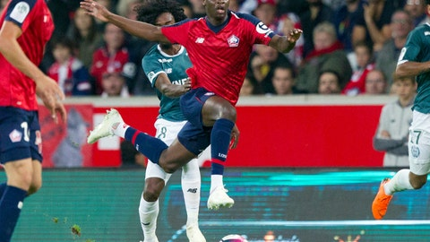 <p>               FILE - In this Saturday, Sept. 22, 2018 file photo, Lille's Nicolas Pepe, center, in action during the French League One soccer match against Nantes at the Lille Metropole stadium, in Villeneuve d'Ascq, northern France.  Arsenal has broken its transfer record on Thursday Aug. 1, 2019, by signing winger Nicolas Pepe from Lille as the London club tries to return to the Champions League.  (AP Photo/Michel Spingler, FILE)             </p>