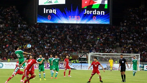 <p>               FILE - In this Thursday, June 1, 2017 file photo, Iraq, in green, in action against Jordan, in red, during their friendly football match in Basra, southeast of Baghdad, Iraq. FIFA says on Tuesday, Aug. 20, 2019 the southern Iraqi city of Basra can host the national team's return to playing World Cup qualifying games at home. Security concerns since the 1980s have forced Iraq to host most qualifiers in neutral countries. (AP Photo/Nabil al-Jourani, file)             </p>