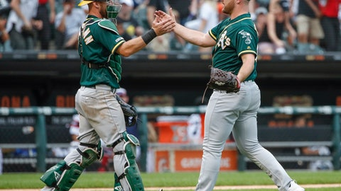 <p>               Oakland Athletics' Liam Hendriks, right, celebrates with Chris Herrmann, left, after delivering a final out against the Chicago White Sox in a baseball game, Sunday, Aug. 11, 2019, in Chicago. (AP Photo/Kamil Krzaczynski)             </p>