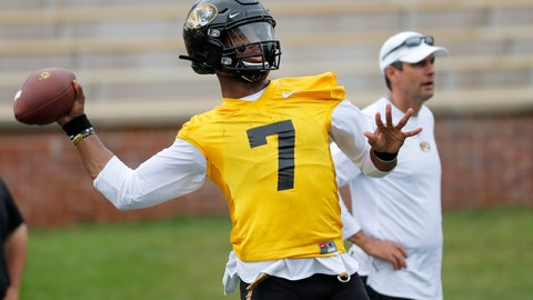<p>               Missouri quarterback Kelly Bryant (7) throws as offensive coordinator Derek Dooley, right, stands off to the side during an NCAA college football practice Monday, Aug. 12, 2019, in Columbia, Mo. (AP Photo/Jeff Roberson)             </p>