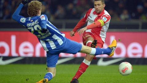 <p>               FILE -- In this Feb. 11, 2013 photo Hertha's Fabian Lustenberger, left, and Union's Torsten Mattuschka, right, challange for the ball during a German second division, 2. Bundesliga, soccer match between Hertha BSC Berlin and FC Union Berlin in Berlin, Germany. (Rainer Jensen/dpa via AP, file)             </p>