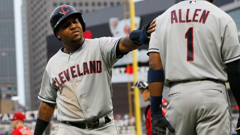 <p>               Cleveland Indians' Jose Ramirez, left, scores on a double by Franmil Reyes off Minnesota Twins pitcher Devin Smeltzer during the second inning of a baseball game Friday, Aug. 9, 2019, in Minneapolis. (AP Photo/Jim Mone)             </p>