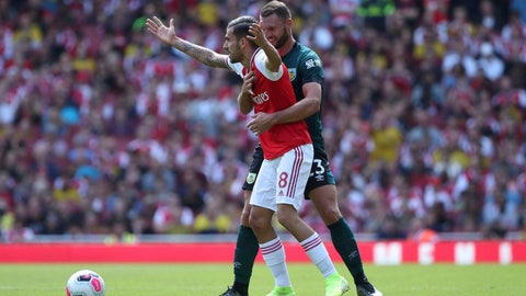 <p>               Arsenal's Dani Ceballos, left and Burnley's Erik Pieters battle for the ball, during the English Premier League soccer match between Arsenal and Burnley FC, at The Emirates Stadium, in London, Saturday, Aug. 17, 2019. (Yui Mok/PA via AP)             </p>