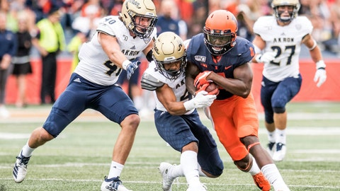 <p>               Illinois's Ricky Smalling (4) is tackled by Akron's John Lasso, left, and Dylan Meeks after making a catch in the first half of a NCAA college football game, Saturday, Aug. 31, 2019, in Champaign, Ill. (AP Photo/Holly Hart)             </p>
