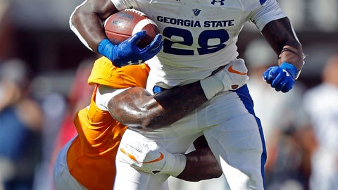 <p>               Georgia State running back Seth Paige (28) tries to escape the grasp of a Tennessee defender in the first half of an NCAA college football game Saturday, Aug. 31, 2019, in Knoxville, Tenn. (AP Photo/Wade Payne)             </p>