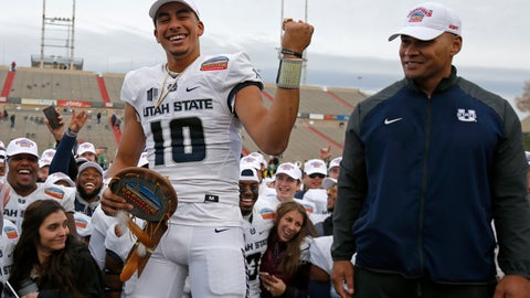 <p>               FILE - In this Dec. 15, 2018, file photo, Utah State quarterback Jordan Love (10) celebrates after being named the Outstanding Offensive Player as interim head coach Frank Maile looks on, following the New Mexico Bowl NCAA college football game against North Texas, in Albuquerque, N.M. Before he blossomed into a Heisman Trophy candidate, Utah State quarterback Jordan Love threw his first career touchdown pass at Wake Forest.  He's looking to fling a few more in his return trip _ and to finish with a different result. (AP Photo/Andres Leighton, File)             </p>