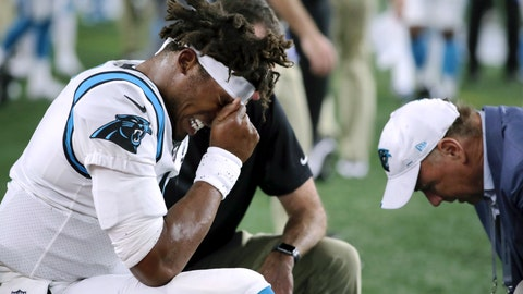 <p>               Carolina Panthers quarterback Cam Newton (1) receives attention on the sideline after an injury in the first half of an NFL preseason football game against the New England Patriots, Thursday, Aug. 22, 2019, in Foxborough, Mass. (AP Photo/Charles Krupa)             </p>