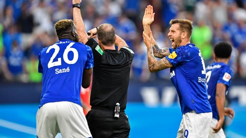 <p>               FILE -- In this Saturday, Aug. 24, 2019 photo Schalke's Guido Burgstaller, right, complains to referee Marco Fritz during the German Bundesliga soccer match between FC Schalke 04 and Bayern Munich in Gelsenkirchen, Germany. Newly implemented handball rules are stoking renewed criticism for the video assistant referee in the Bundesliga. (AP Photo/Martin Meissner, file)             </p>