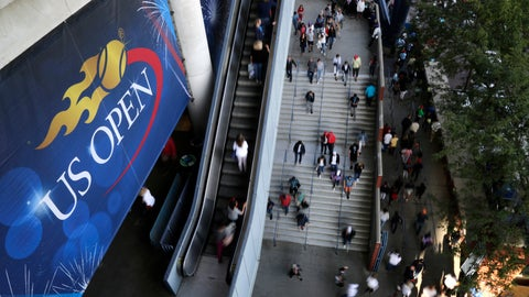 <p>               FILE - In this Sept. 3, 2017, file photo, tennis fans move in and out of Arthur Ashe Stadium during the fourth round of the U.S. Open tennis tournament in New York. How much does each first-round loser in singles at the U.S. Open take home in prize money? Who holds the women's record for most aces in the tournament? See how much you know about the year's last Grand Slam tennis tournament by taking the AP's U.S. Open quiz. (AP Photo/Frank Franklin II, File)             </p>