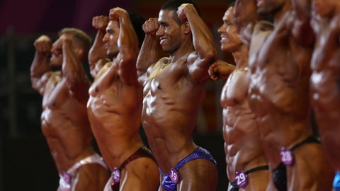 <p>               Competitors flex their muscles in the men's classic event at the debut of bodybuilding as an official sport at the Pan American Games in Lima, Peru, Saturday, Aug.10, 2019. (AP Photo/Rodrigo Abd)             </p>