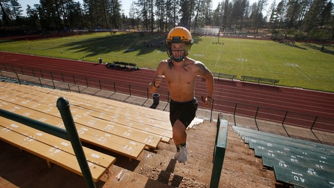 <p>               In this Thursday, Aug. 22, 2019, photo, Paradise High School football player Lukas Hartley runs up the stairs of the football stadium after practice in Paradise, Calif. Paradise's game against Williams High School on Friday will be the first game for the team since a wildfire nearly destroyed the foothill community last year. (AP Photo/Rich Pedroncelli)             </p>