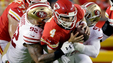 <p>               Kansas City Chiefs quarterback Chad Henne (4) is sacked by San Francisco 49ers defensive lineman Damontre Moore (92) and defensive end Arik Armstead (91) during the first half of an NFL preseason football game in Kansas City, Mo., Saturday, Aug. 24, 2019. (AP Photo/Charlie Riedel)             </p>