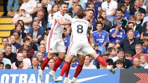 <p>               Sheffield United's Callum Robinson, centre, celebrates scoring his side's first goal of the game during their English Premier League soccer match against Chelsea at Stamford Bridge, London, Saturday, Aug. 31, 2019. (John Walton/PA via AP)             </p>