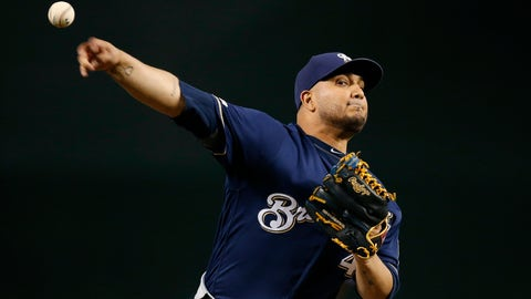 <p>               FILE - In this July 19, 2019 file photo, Milwaukee Brewers starting pitcher Jhoulys Chacin warms up during the first inning of a baseball game against the Arizona Diamondbacks, in Phoenix. Chacin helped buy plane tickets for a young Venezuelan team to compete in a tournament in Mexico, which they went on to win. It was a bright spot for a country more accustomed to news about political conflict and economic turmoil. (AP Photo/Ross D. Franklin, File)             </p>