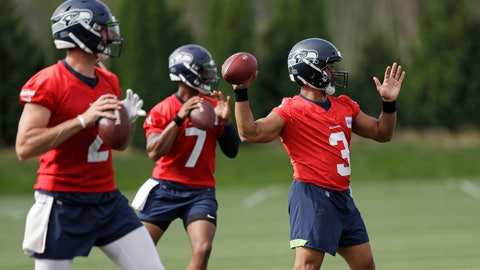 <p>               Seattle Seahawks starting quarterback Russell Wilson (3) leads Paxton Lynch (2) and Geno Smith (7) in a quarterbacks drill at an NFL football training camp Thursday, Aug. 1, 2019, in Renton, Wash. (AP Photo/Elaine Thompson)             </p>