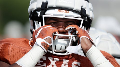 <p>               Texas running back Keaontay Ingram adjusts his helmet during a morning practice at the team's facility in Austin, Texas, Wednesday, Aug. 7, 2019. (AP Photo/Eric Gay)             </p>