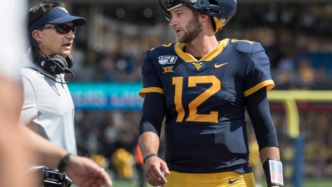 <p>               West Virginia head coach Neal Brown, left, and quarterback Austin Kendall, right, chat in-between plays during the first half of an NCAA college football game against James Madison Saturday, Aug. 31, 2019, in Morgantown, W.Va. (AP Photo/Raymond Thompson)             </p>