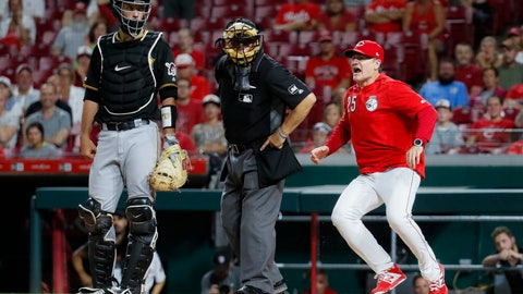 <p>               Cincinnati Reds manager David Bell (25) runs up to umpire Larry Vanover, center, to argue a called strike against Yasiel Puig during the ninth inning of a baseball game against the Pittsburgh Pirates on Tuesday, July 30, 2019, in Cincinnati. (AP Photo/John Minchillo)             </p>