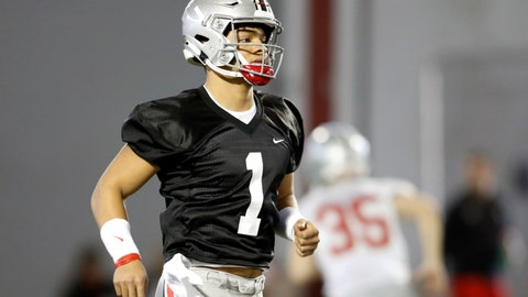 <p>               FILE - In this March 6, 2019, file photo, Ohio State quarterback Justin Fields runs through a drill during an NCAA college football practice in Columbus, Ohio. Lots of people are curious to see how No. 5 Ohio State is going to fare in its first game with a new head coach and a new, untested starting quarterback. That includes the new coach, Ryan Day. He's as curious as anybody to see what's going to happen. (AP Photo/Paul Vernon, File)             </p>