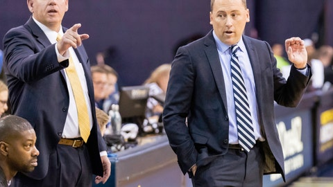 <p>               This photo provided by Northern Arizona Athletics shows Shane Burcar, left, who has taken over as Northern Arizona's head basketball coach after Jack Murphy, right, left to become the associate head coach at Arizona. Burcar was a career high school coach before joining Murphy's staff in 2018 and was named interim coach after Murphy left in June. (Northern Arizona Athletics via AP)             </p>