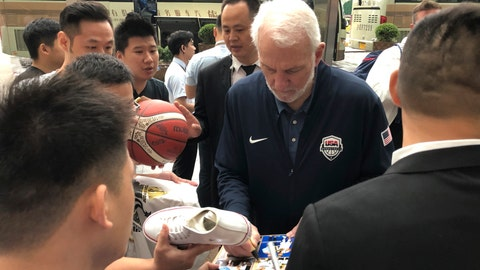 <p>               U.S. men's basketball coach Gregg Popovich signs autographs for fans Thursday, Aug. 29, 2019, at the team hotel in Shanghai upon arrival for the World Cup. The team will play three first-round games starting Sunday. (AP Photo/Tim Reynolds)             </p>