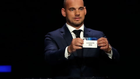 <p>               Dutch former soccer player Wesley Sneijder shows the name of Liverpool during the UEFA Champions League group stage draw at the Grimaldi Forum, in Monaco, Thursday, Aug. 29, 2019. (AP Photo/Daniel Cole)             </p>