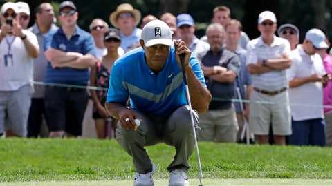 <p>               Tiger Woods reads the fourth green during the first round of the BMW Championship golf tournament at Medinah Country Club, Thursday, Aug. 15, 2019, in Medinah, Ill. (AP Photo/Nam Y. Huh)             </p>