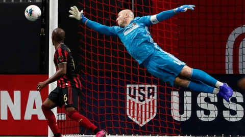 <p>               Atlanta United goalkeeper Brad Guzan (1) dives to block a shot during the first half of the U.S. Open Cup soccer match against the Minnesota United Tuesday, Aug. 27, 2019, in Atlanta. (AP Photo/John Bazemore)             </p>