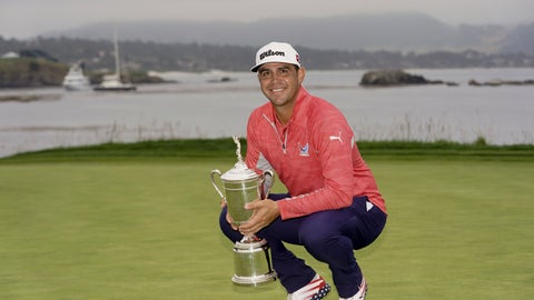 <p>               FILE - In this Sunday, June 16, 2019 file photo, Gary Woodland posses with the trophy after winning the U.S. Open Championship golf tournament  in Pebble Beach, Calif. Woodland says he couldn't truly enjoy winning the Open until his wife gave birth to twin girls last week. (AP Photo/Carolyn Kaster, File)             </p>