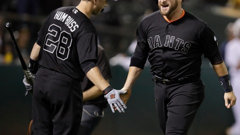 <p>               San Francisco Giants' Stephen Vogt, right, celebrates with Buster Posey (28) after hitting a three-run home run off Oakland Athletics' Ryan Buchter during the eighth inning of a baseball game Saturday, Aug. 24, 2019, in Oakland, Calif. (AP Photo/Ben Margot)             </p>