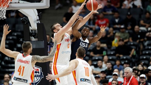 <p>               United States' Harrison Barnes, center right, is defended by Spain's Marc Gasol, center left, during the first half of an exhibition basketball game Friday, Aug. 16, 2019, in Anaheim, Calif. (AP Photo/Marcio Jose Sanchez)             </p>
