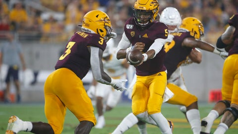 <p>               Arizona State quarterback Jayden Daniels (5) hands the ball off to running back Eno Benjamin (3) during the first half of the team's NCAA college football game against Kent State, Thursday, Aug. 29, 2019, in Tempe, Ariz. (AP Photo/Ralph Freso)             </p>