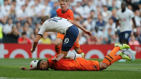 <p>               Tottenham's Harry Kane falls after he was tackled by Newcastle's Jamaal Lascelles during the English Premier League soccer match between Tottenham Hotspur and Newcastle United at Tottenham Hotspur Stadium in London, Sunday, Aug. 25, 2019.(AP Photo/Frank Augstein)             </p>
